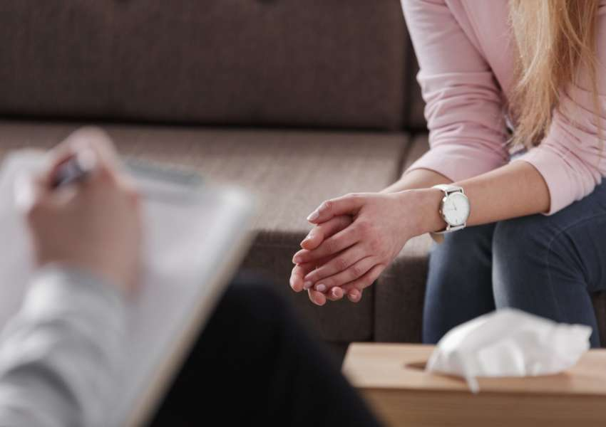 close-up-of-womans-hands-during-counseling-meeting-EWPC5G8-min